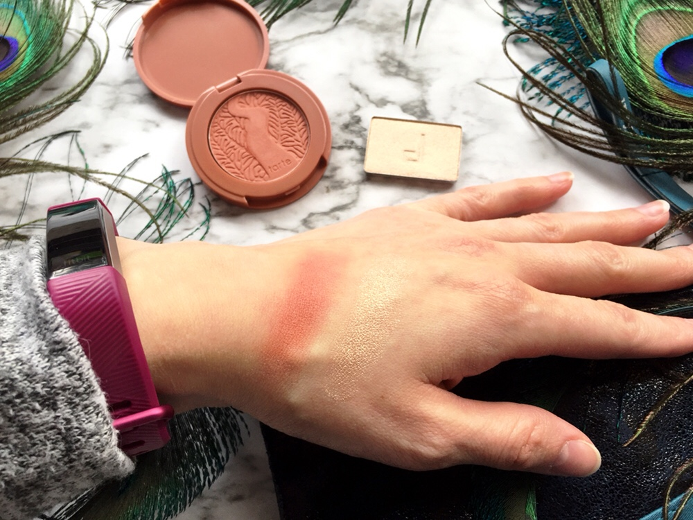 "Swatches of Tarte Amazonian Clay 12-Hour Blush in ""Feisty"" and Doucce Freematic Highlighter in ""Solstice"""